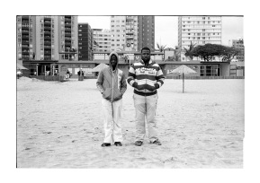Two men standing infront of the South Beach life saving club.