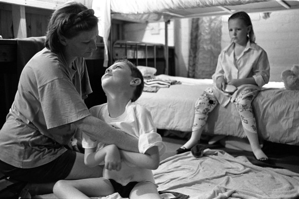 Louis with his mother and sister at their home