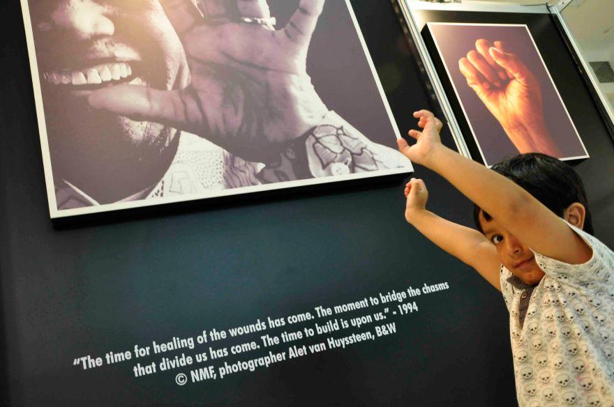 TRISTAN MOODLEY (3) OF PIETERMARITZBURG TAKES IN IMAGES OF NELSON MANDELA. PHOTO/JOHN ROBINSON