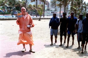 Durban in off season. Gaura Sundara a Hare Krishna devotee from Ukraine gives out flyers and booklets to passersby. September 2016, Durban, South Africa, John Robinson