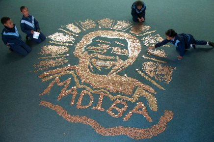 Learners at Longmarket Girls School in Pietermaritzburg make a portrait of Nelson Mandela out of South African coins on 18 July 2013 International Madiba Day, the coins collected will go to a worthy cause in the City of Pietermaritzburg. 18 July 2013 Pietermaritzburg South Africa Photo John Robinson