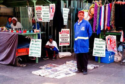 Durban's people. Nelson is a newspaper vendor outside the Durban Central Post Office on Pixley KaSeme Street, Durban, South Africa.