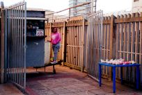 Durban's People. Tinky is a shop manager of a kiosk on Gillespie Street, selling fresh fruit and snacks in the Point area of Durban, South Africa.
