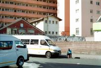Durban's People. Taxi driver and 2 taxis at the Alexandra Street taxi ranks, Durban, South Africa.