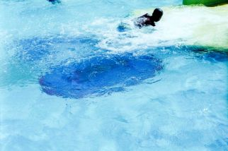 Durban beachscapes, a child plays in the shallow paddling pools on the beach front.