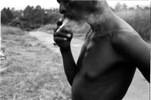 A worker pauses from clearing graves for a smoke.