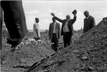 Pastors blessing the dead, while a grave digger looks on.