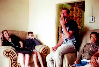 Douglas Wood the groom relaxes with his children and grand children in his home in Mduku Village in KwaZulu Natal, South Africa.
