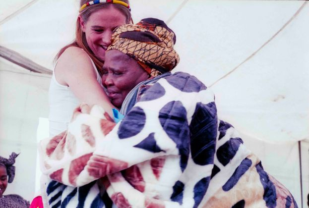 An elder woman of the bride's family hugs the daughter of the groom in thanks for the new blanket given to her. The bonds between the two families created by the labola process give the new couple a strong base for their life together, divorce is rare in Zulu culture.