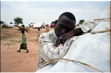 ipjr09440625 September 2004 Kalma IDP Camp Nyala Janub Darfur Sudan Mansoor, now lives at the Kalma IDP camp he lost his village in a raid. An IDP (Internially Displaced People) Camp on the outskirts of the town of Nyala. There are about 80,000 people who have been displaced from their villages by the Janjaweed milita, that raped, murdered and burned and their villages forsing them to leave and seek refuge in IDP camps across the Darfur region of Sudan. The Janjaweed milita is backed by the Government of the Sudan. ©John Robinson/MCC/South Photographs africa afrika afrique arab african genocide janjaweed milita armed horsemen. refugees refugee