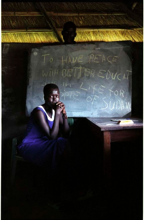"""ipjr09441717 September 2004 Rumbek Al Buhayrat Sudan The New Sudan """"Give us an education"""" Rebbeca Akoi The returned people, the war in the south of the Sudan has been around for 50 years. The students of Rumbek, these students have been at war or at least affected by war. They could be orphans, they have run from war. For their age they should be in university, they are still working on their high school education... ©John Robinson/MCC/South Photographs africa afrika afrique sudan The New Sudan war refugee refugees returned exiles exile education reconstruction villagers villager village food"""