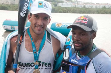 Andy Birkett, winner, and Sbonelo Khwela in second place of the FNB Duzi 2019 K1 mens race at the finish line in Durban.