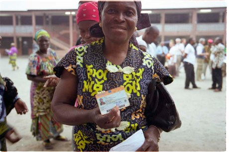 ipjr10614913 july 2006 kinshasa democratic republic of congo libres et justes (free and fair) woman and her voter's card. the democratic republic of congo held the first round of elections (30 july 2006) in 45 years of the country's history. the electorate were asked to elect members of parliment and a president of state. these images are an edit from material produced for mcc and the ecc urgent peace project © john robinson/mcc/south photographs elections vote kinshasa democratic republic of congo republique democratique du congo mcc ecc urgent peace project africa afrique voters education