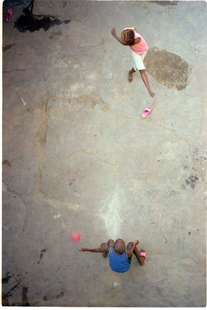 ipjr10615016 july 2006 kinshasa democratic republic of congo libres et justes (free and fair) children playing football in the santuary of a city compound the democratic republic of congo held the first round of elections (30 july 2006) in 45 years of the country's history. the electorate were asked to elect members of parliment and a president of state. these images are an edit from material produced for mcc and the ecc urgent peace project © john robinson/mcc/south photographs elections vote kinshasa democratic republic of congo republique democratique du congo mcc ecc urgent peace project africa afrique voters education