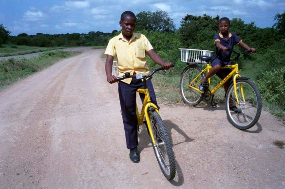 School students on bicycles provided by a project to aid rural school students with school fees and transport. development, roads, education, water, farmers, farming, soy beans, irrigation, rural projects in the dundee, jozini, ulundi and kwamashu areas of kwazulu-natal south africa. March 2009. N.B. NOT FOR SA PUBLICATION PRIOR TO 30 JUNE 2009. PHOTO/JOHN ROBINSON