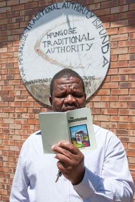 CREATE CBR DISABLE RIGHTS Traditional leader reading the South african Constitution.