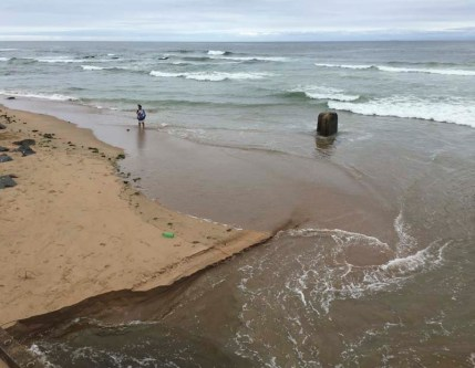 Cuttings Beach is at 29,58.1213S and 30,88.7092E and is accessed via Tanjor Drive in Merewent south Durban. Cuttings Beach is not a pretty place but it is an outlet for many in the local community. Cuttings Beach has a health warning banning swimming in the sea. There is a canal often flowing plastic bottles into the sea and an outlet from local factories that lets factory effluent onto the sand here. But still the people have claimed this space for themselves. Here at Cuttings' the people pray, here at Cuttings' the people use the slime in the canal as bait for the local mullet fish and any other in these less then perfect waters. Here at Cuttings' other people just come for quiet time with another. The city council is now busy working on the waste water outlet, they have been on the job for a long time now; and some locals don't see the end of the project any time soon either.