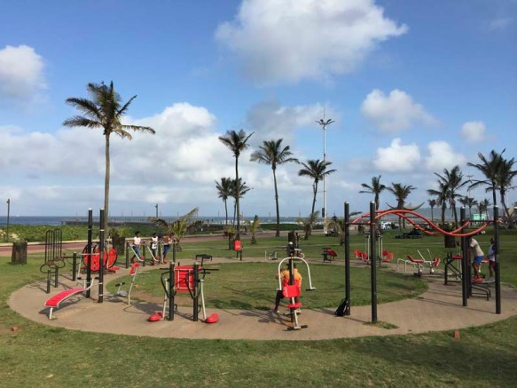 Near 29,50.8123S and 31,2.2053E there is a city open air gym, this gym is one of many city open air gyms in Durban, these gyms are free to use and they are provided by the metro council, they are basic and work with the body weight of the user. The Durban beach front while during the day is the domain of the casual visitor, in the evenings it is the domain of fitness groups and runners who use the area for running, cycling, fitness training and beach soccer.