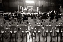 ipjr08360109 Fight Club - A Picture Story by John Robinson 11 May 2003 Pietermaritzburg South Africa Fight club, YMCA Pietermaritzburg. High kicks and punches smack into bodies as the fighters compete, the seconds shout instructions to their fighters, the fancy outfits that clothed their men on that walk from the change rooms count for naught once the clash begins. Only hard kicks will stop the other man. The meek might gain the world, but here only the hardest man will get the purse. ©John Robinson/South Photographs africa afrika afrique sport kick boxing fight tournament