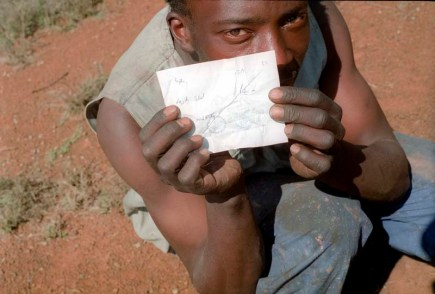 A waste picker shows his receipt for the sale of precious metals to a city scrap dealer.